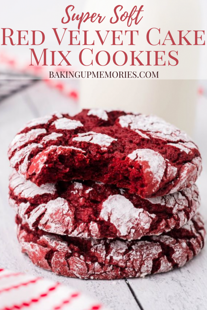 Three red velvet cake mix cookies stacked with a bit taken out of the top cookie.
