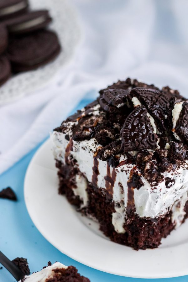 Oreo Poke Cake on a white plate