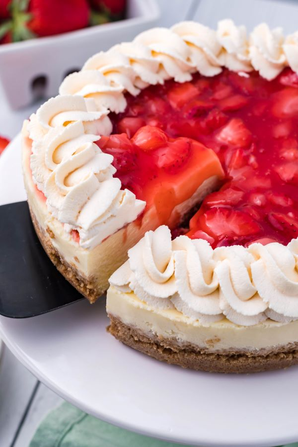 A slice being removed from the Instant Pot Strawberry cheesecake.