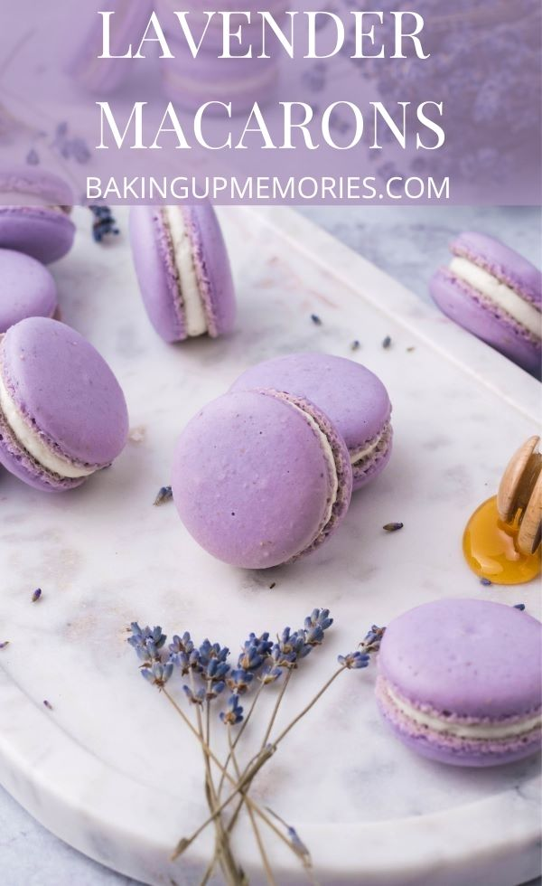 Macarons on a marble slab with lavender buds